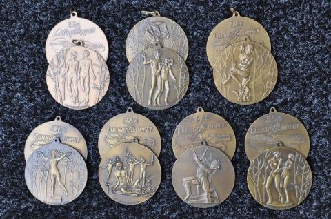 Lingöloppsmedaljer från 90-talet med Carl Milles motiv.